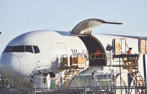 cargo-plane-being-loaded-to-deliver-packages-acros-3QPPE2W
